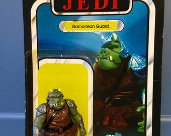 1983 vintage Star Wars Return of the Jedi ROTJ Gamorrean Guard action figure with weapon and card back