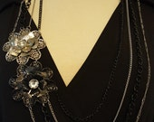 Black Tie Affair - Four Strand Necklace with Black & Silver Flower Pendants