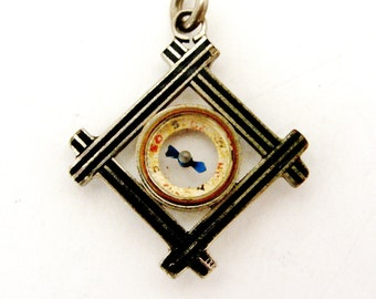 French antique compass fob with black enamel.