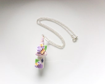 Fairy house necklace in pacy and lilac colours handmade from polymer clay