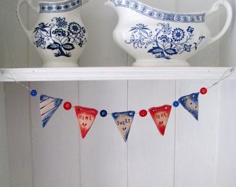 Home Sweet Home - mini ceramic bunting with buttons. Made in Wales, UK. Red and blue.