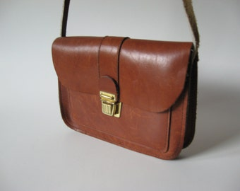 Rectangular vintage 80s sienna brown leather small festival bag purse with gold clip closure