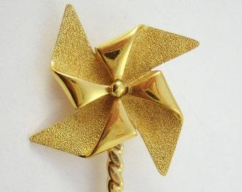 Vintage pinwheel brooch with spinning wheel