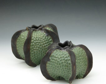 Dark green & brown carved porcelain urchin