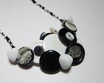 White elephant vintage button necklace and  beaded  black and white bracelet