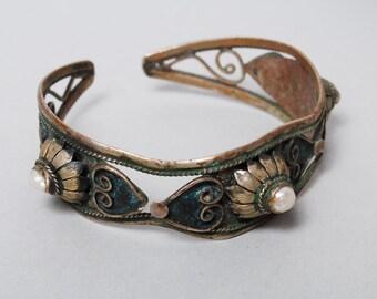 Old vintage cuff bracelet, ethnic stile old patina, embellished with mother of pearl.