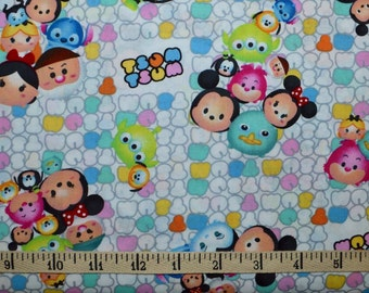 Springs Creative.  Tsum Tsum Group Toss Patterned Logo  -  By the yard - Choose your cut.