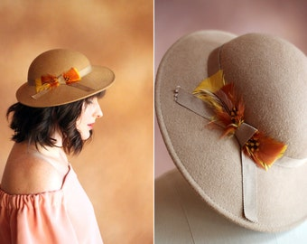 vintage 1970's tan wool tilt hat with orange & yellow feathers bow / size s - m