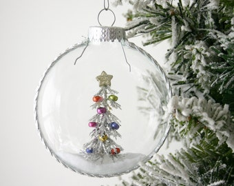 Snow Globe Ship In A Bottle Style Flat Glass Ornament with Silver Tree