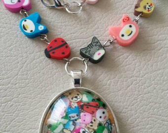 Sale was 24 now 20uk Animal Faux Mille Fiori Pendant on Fimo Animal Bead Necklace.