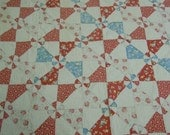 Vintage quilt: Hearts and Gizzards  1940's  floral and print fabrics hand pieced and quilted cotton batting four borders