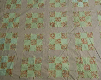 """Quilt/comforter  Nine patch design with 3"""" borders and  a floral fabric used as batting.  73"""" x 82"""""""