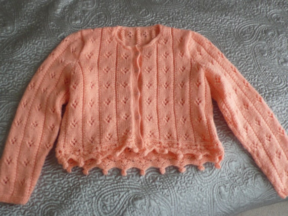 Cropped acrylic apricot cardigan with pretty hem detail 70s but unworn S / M