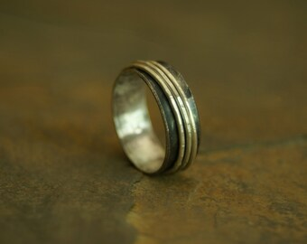 oxidized sterling silver fidget ring with bright spinners