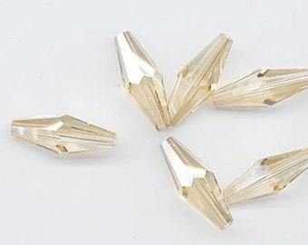 Twelve Swarovski crystal beads - Art. 5205 - 20 x 8 mm -crystal golden shadow