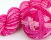 "Self Striping Sock Yarn, Superwash Merino and Nylon Fingering Weight, in ""Think Pink"""
