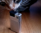 Vintage White Gold plated Braun Mach 2 Pocket Lighter designed by Dieter Rams and Florian Seiffert 1970s design