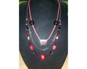 Red and black multi strand necklace (214)