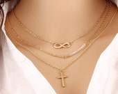 Gold Plated Metal Chain with Infinity, Crystrals, and Cross Charm Layered Multi-Strand Necklace Women's
