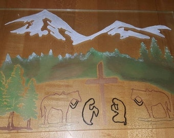 Hand etched and painted praying cowboy / mountain scene on repurposed glass shelf