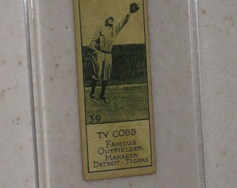 new just in 1924 Williard's Chocolate's ty cobb in a screwdown case looks extremely real
