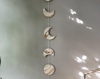 White and gold phases of the moon wall hanging