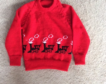 Childs machine knitted jumper