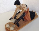 Vintage diorama women rolling dough wood base handmade unknown country