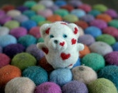 A little bear decorated with hearts - needle felted animal - small cute friend