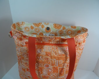 Handmade quilted orange tote bag, large with a zippered  I Pad pocket and magnetic closure