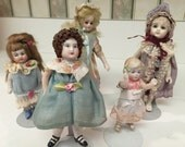 Set of 5 Bisque Dolls that range in age and sizes  Very Nice!