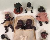 8 Rare pieces of Black memorabilia 4 Porcelain bisque dolls, bisque bathroom and celluloid babies