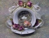 Little Bird Guarding Her Nest In A Teacup