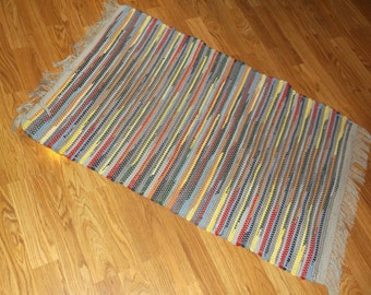 Hand-woven, Roy G Biv, Rag Rug, made of recycled sheets and sewing scrapes.