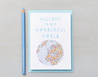 Welcome to our wonderful world card in Blue. Sweet, happy new baby card.