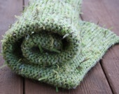 Photo prop blanket knitted in green