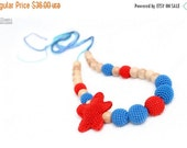 25% off Nursing necklace - Maternity necklace - Organic Juniper jewelry - red amigurumi starfish and blue crochet beads