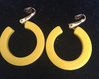 Yellow clip on hoops