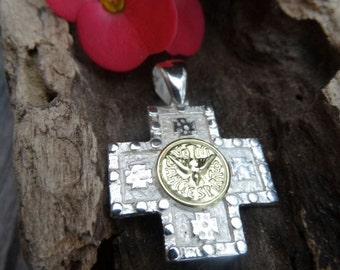 Holy Spirit equilibrium cross. Two tone. Sterling silver and 18k goldfield.