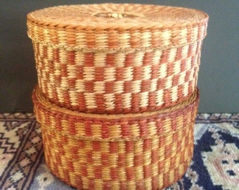 pair of lidded woven baskets