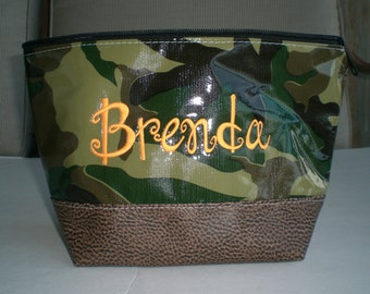Camo two tone monogrammed oilcloth cosmetic with faux leather bottom