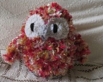 Multicoloured owls made from eyelash yarn.