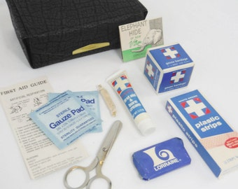 Vintage 70s 80s portable first aid kit with black  faux elephant leather pouch gauze bandage medical scissors smelling salts