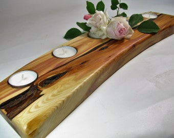 Curved split log tea light candle holder. Rustic juniper wood tea light candle holder.