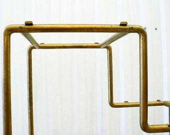art deco brass copper tube shelf from the 30's metal shelf rack display