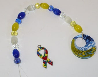 Maize and blue catseye and crystal suncatcher.