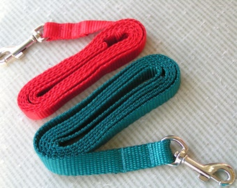 Two 4 foot plain nylon webbing leashes in Red or Teal.  If a business would want all of them contact me for discount and proper postage.