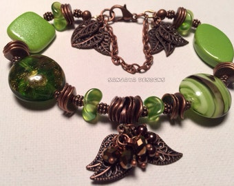 Green beaded and copper bracelet