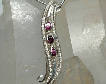 Garnet wire wrapped silver pendant
