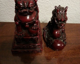 Two Chinese Red Dragon Figurines